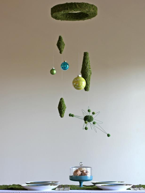 How to Make Midcentury Modern Christmas Decorations : A centerpiece doesn't always have to sit on the table, sometimes it can orbit above the table. It won't get in the way when trying to talk to someone across the table and it leaves more room for all of the tasty food and sweet treats.  From DIYnetwork.com