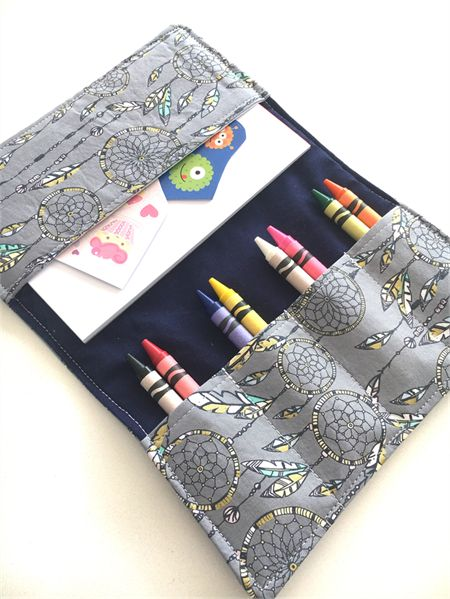 Dreamcatcher Crayon Wallet with 8 crayons , pad and stickers. Great travel companion.