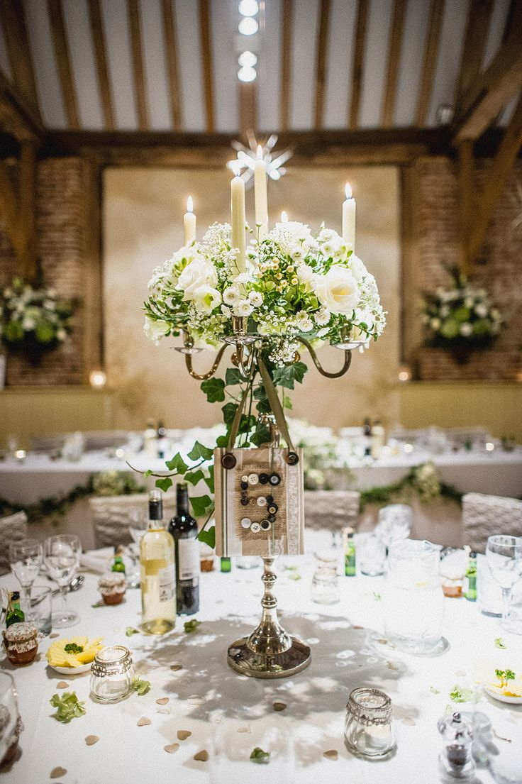 Long Candles Finished With Some Beautiful Flowers This Centrepiece Would Go Well My Castle Wedding Candelabrawedding Table Centrepiecele