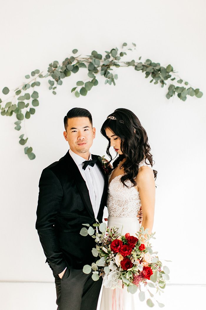 A modern minimalist wedding shoot that showcases simple style and a stunning color palette of oxblood red and slate blue with organic greenery!