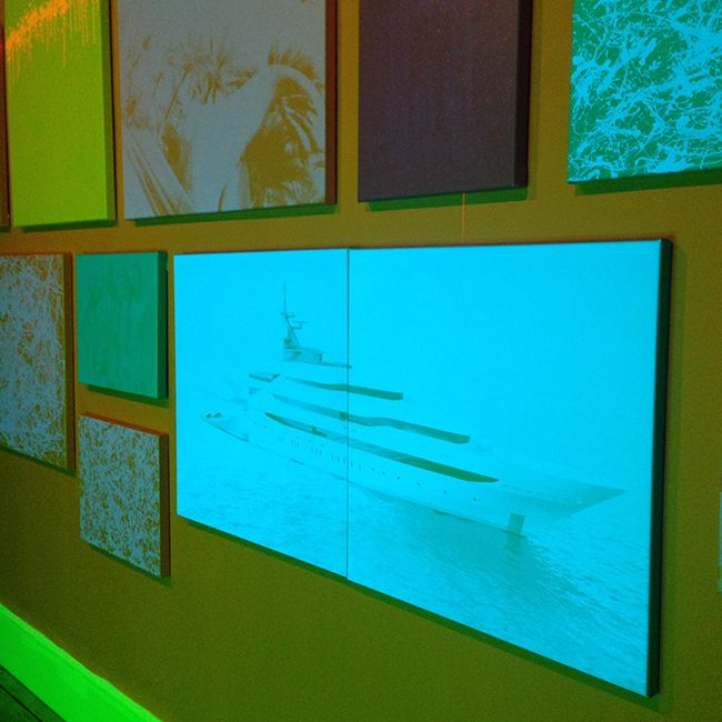 In Zevs' version we see oil company logos on the wall of the modernist building, melting realistically down into the pool, where they create rainbow sheens of pollution. The Hockney-inspired section occupied the first room in the gallery, can be seen from the street. The second phase of the exhibition runs into the back room.