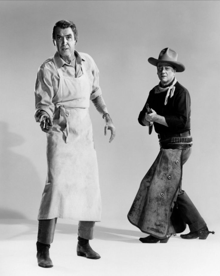 THE MAN WHO SHOT LIBERTY VALANCE (1962) - James Stewart & John Wayne - Directed by John Ford - Paramount - Publicity Still.