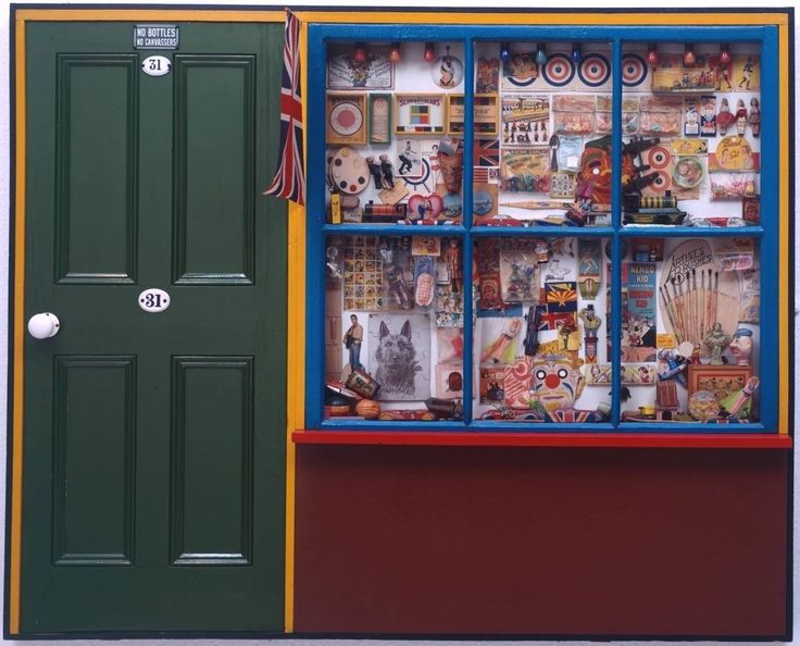 Peter Blake 'Toy Shop' 1962. His work suggests a sense of nostalgia for the paraphernalia of his childhood. Blake collected old toys and related imagery; this piece developed as both a work of art and a store for his collection of objects. http://www.tate.org.uk/art/artworks/blake-the-toy-shop-t01175