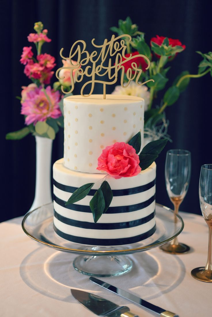 Modern fun wedding cake with black stripes over a sleek white cake and gold polka dots, with a fun pop color sugar peony. Country Cake Shop
