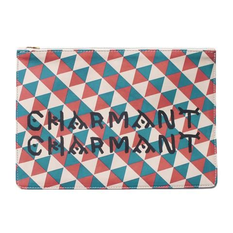 This Clare Vivier leather clutch is an elegant evening bag or perfect with blue jeans. Printed with red and blue triangles, and CHARMANT CHARMANT in yellow, the design was inspired by a vest from LACM