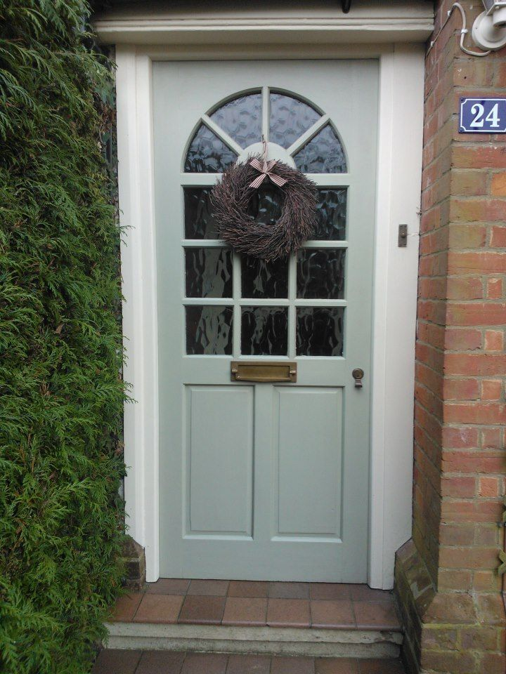 Christine's festive front door painted in French Gray with a New White surround.