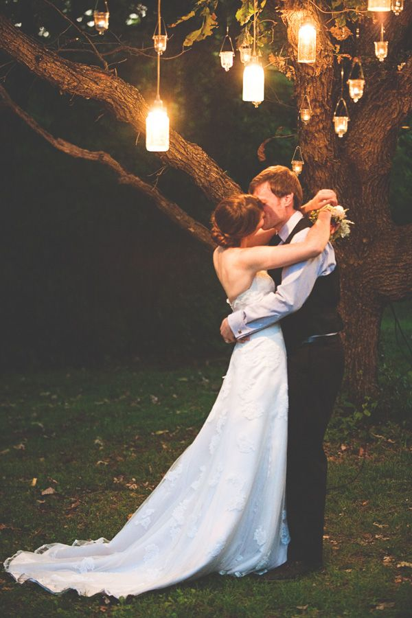 Okay...I officially want to do the cake thing, dance, kiss, and much more under a tree hanging lights!