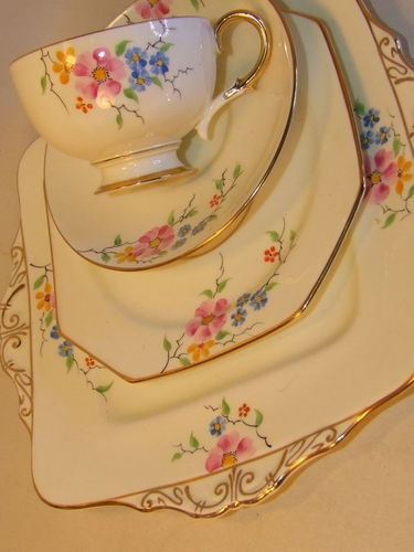 Beautiful vintage tea setting in lovely soft creams with a floral embellishment. A pleasure to have tea from - enjoy.