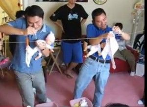 baby shower games for men- For this baby shower game, you will need a few dolls, strings tied to two walls, clips, bucket and baby's clothes (nappies, sheets, baby-suits etc. ). When the game begins, the husbands will hold the dolls just like we hold the babies, hold the telephone on shoulders and then they have to hang the baby's clothes on the string using the clips.