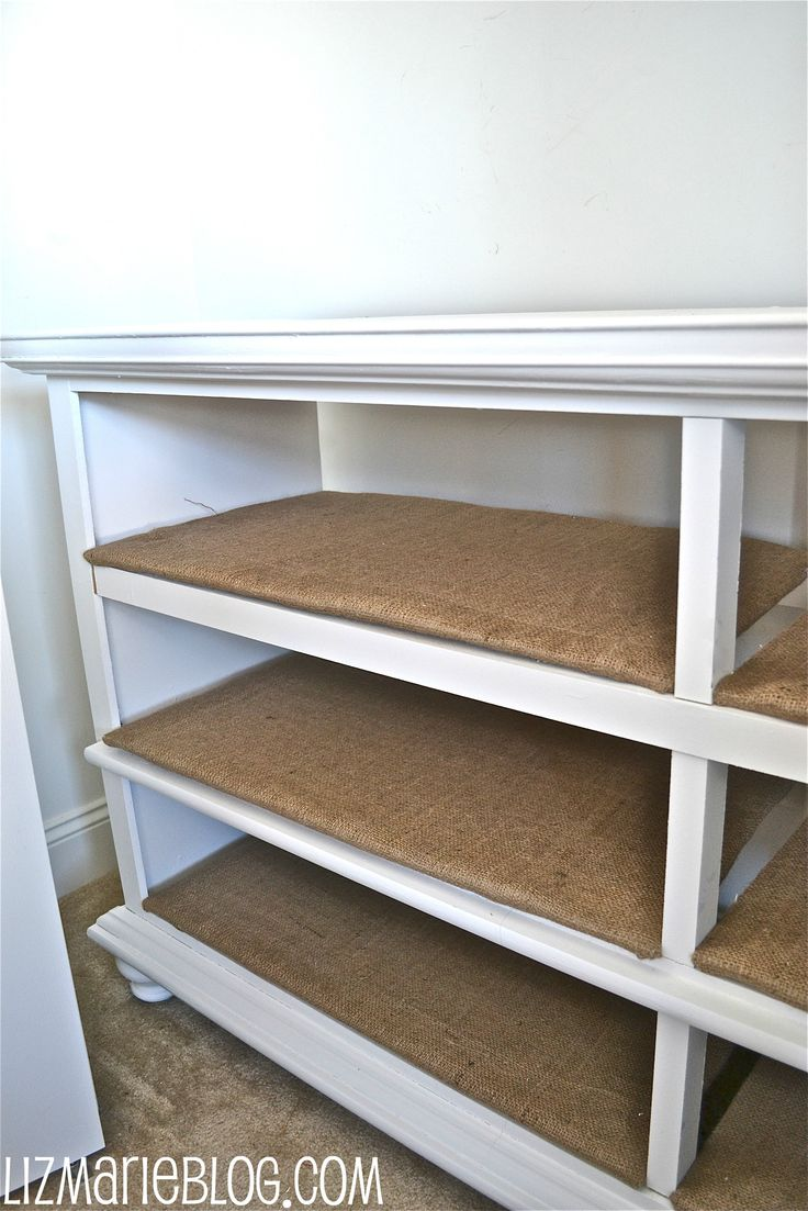 turn an old dresser into open shelving. Cover shelves with burlap. J's old dresser maybe?