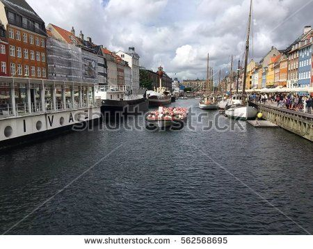 Nyhavn is a 17th-century waterfront, canal and entertainment district - Copenhagen, Denmark/ Copenhagen, Denmark.
