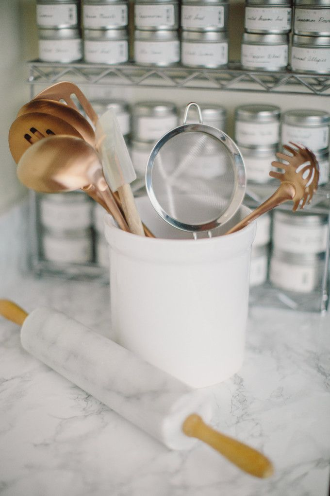 Style Me Pretty: Behind the Blog - white marble kitchen counter + copper cookware
