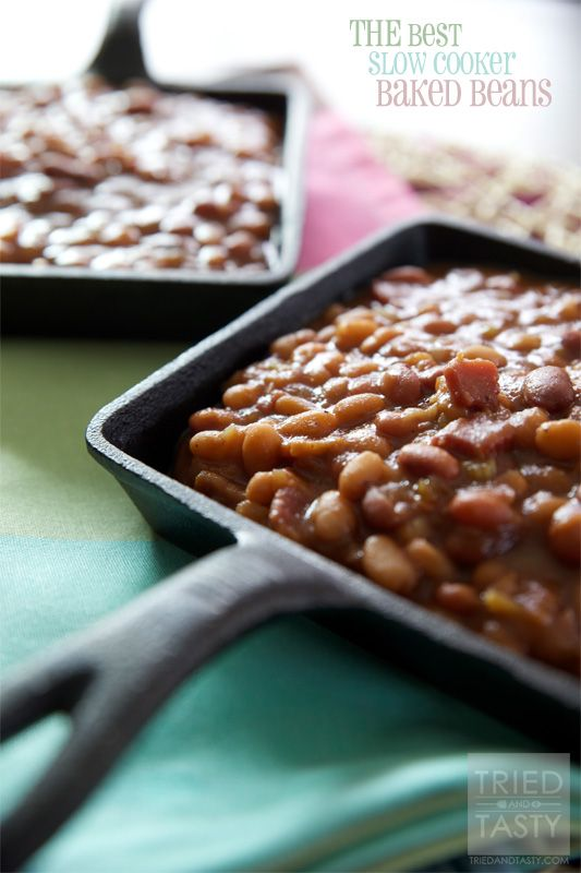 THE Best Slow Cooker Baked Beans // You haven't had baked beans until you've had these. Made easy with your slow cooker, the smell will bring your friends, family, neighbors, and coworkers knocking at your door! These complete your BBQ menu, do not go looking for any other recipe: this is the baked beans recipe for you! | Tried and Tasty