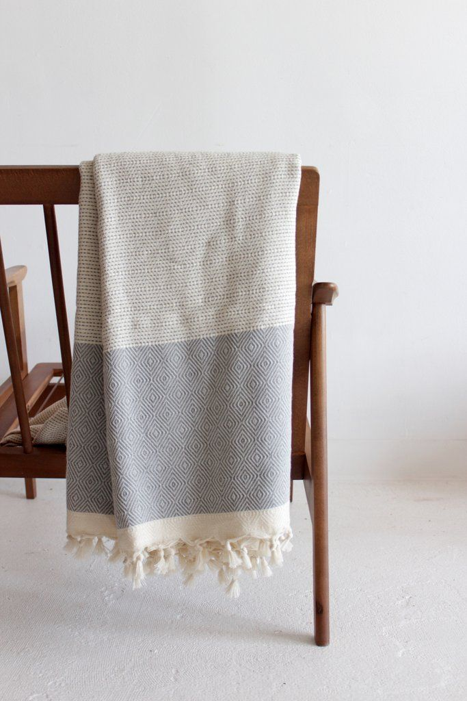Neutral and simple grey turkish cotton throw made with traditional, sustainable practices in Turkey. Dotted pattern through center of blanket with a more detailed print at the ends and tassels. - 100%
