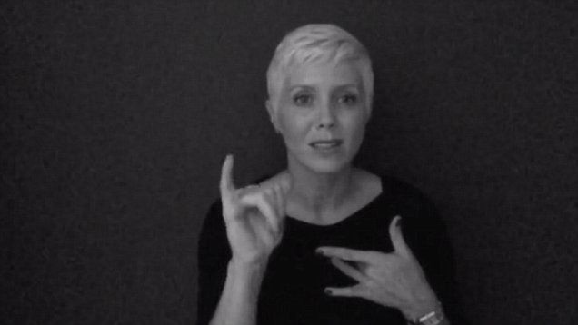 ASL interpreter Molly Bartholomew beautifully signs Adele's latest song 'Hello' in touching video.