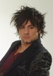 Razor cut male hairstyle with length on top. http://www.hairfinder.com/haircollections/razor-cut-hair.htm