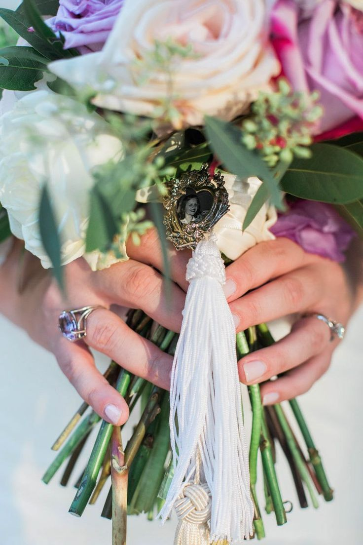 Bridal Bouquet Tied Together with a Sentimental Picture https://www.thecelebrationsociety.com/weddings/trendy-stylish-gold-pink-wedding-villa-de-suenos-st-simons-island-ga/