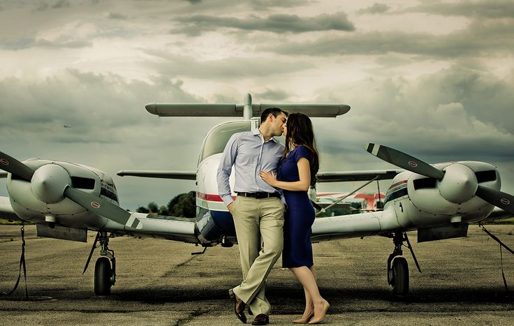 Creative engagement photoshoot with airplanes. Photography by Dmitri Markine