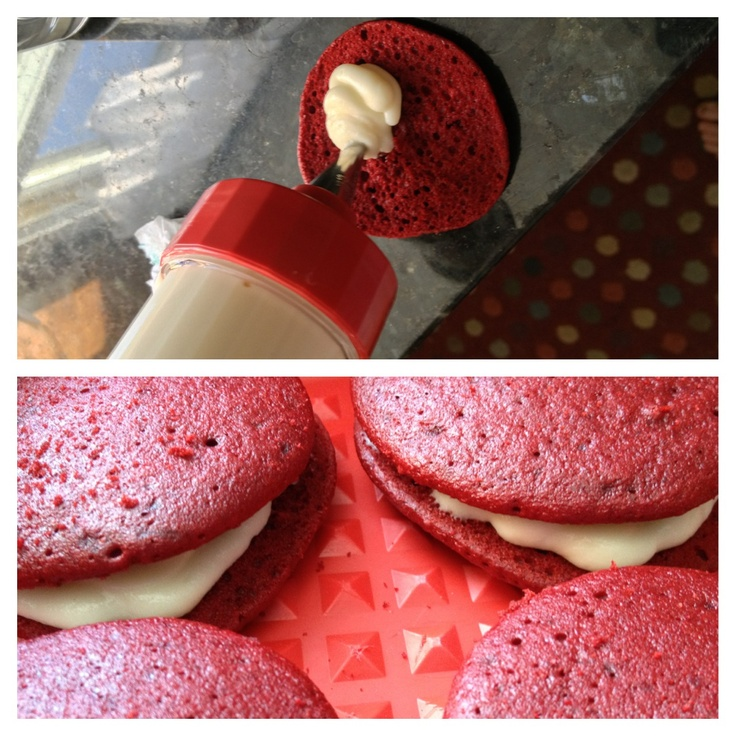 Red velvet moon pies with cream cheese frosting.   This frosting was super easy to make: 8 ounces of cream cheese 1/2 cup softened butter 2 cups sifted confectioners sugar (you can use less if you want it to be more tart) 1 teaspoon vanilla extract   Let it sit in the fridge for at least a half hour before using it :)