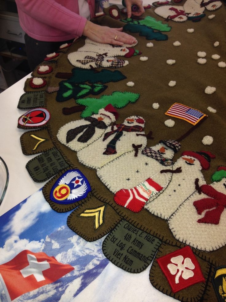 This is a tree skirt made from all recycled materials. It is a felted army blanket and uses patches from the makers Grandfather who fought in WW1, father who fought in WW2, and her husband who fought in Vietnam. Such an amazing piece and a wonderful tribute.
