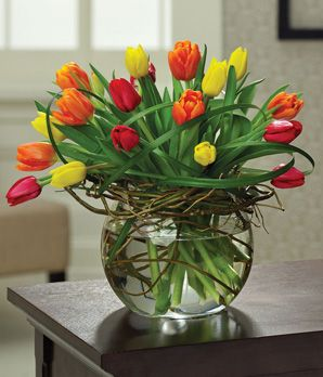 tulips circular flowers = 20ish tulips/wreath/wirey green swirl = outstanding! = L