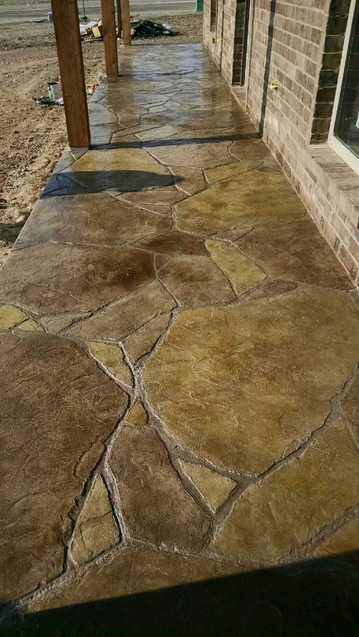 Stamped and stained concrete patio in flagstone!!
