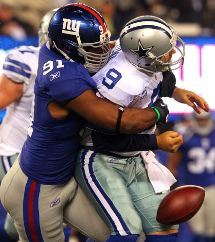 The Giants' Justin Tuck sacked the Cowboys' Tony Romo and forced a fumble with 1:41 to play, effectively ending the game.
