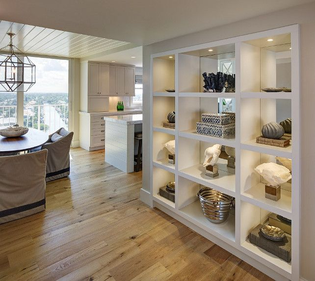 A great way to open up a small space. Turn a dividing wall into an open cubby wall. Allows increased decorating and/or storage, but also flow of air, light, and sound