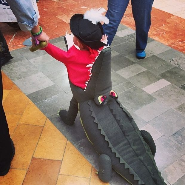 Captain Hook being eaten by Tick-Tock the Crocodile from Peter Pan. | 21 Awesome Kids' Halloween Costumes To Start Making Now