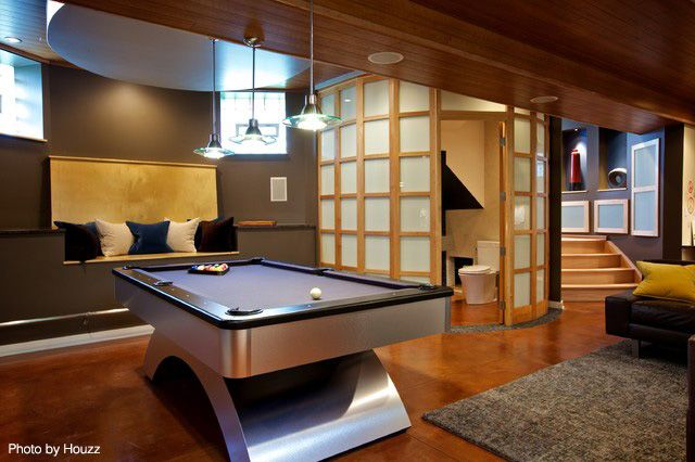 Renovated basement with hardwood flooring throughout, a modern pool table, a bit of an Asian theme and intriguing lighting options. Click on the pin to see the best flooring options for basement flooring. #basements