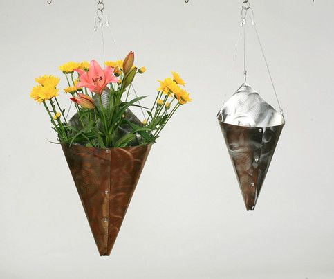 When I was younger and got flowers they would end up in a plastic pitcher, but now I have one of these in my living room. It hangs from the ceiling out of the way, and not taking up space in my cabinets. I think it looks a little bit better than the pitcher. It is also a friendly reminder, when e...