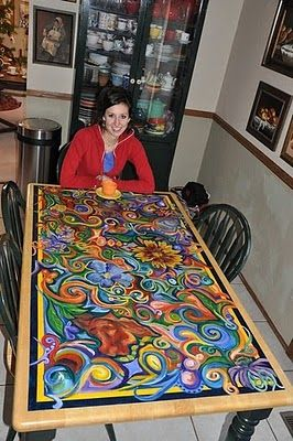 My sister (this isn't her) did something very similar and equally stunning to my parents' old kitchen table when she was in college.  I've considered several times asking my sister if she could help do something similar to my table, too.