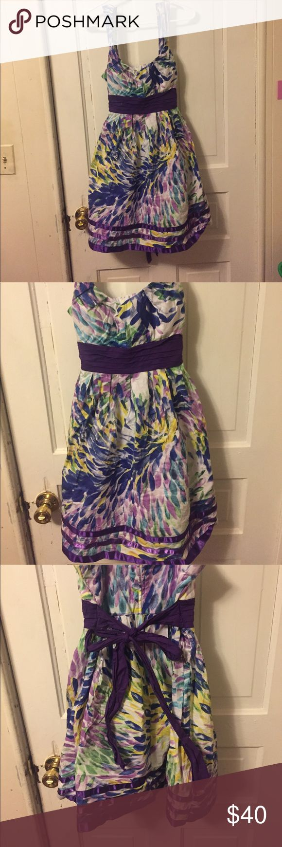 A beautiful multi colored party dress!🎀 Main color is purple. With blue green and yellow. Has a lace underneath. Tie back. Zip up. Dresses