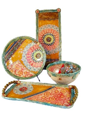 Handmade Serving Pieces at Quirks of Art by our favorite ceramic artist! Made of stoneware clay and all glazes are food safe. Can be warmed in the oven and are dishwasher safe. Slight variations in color, size and shape due to the handmade nature of the work. Beautiful colors blend together with complimentary patterns of floral, texture, lace detail, mandalas and even Celtic knots. Very eclectic. Platters and trays can be wall hung with attached wire. $69-$300. In store today! -Quirks of Art