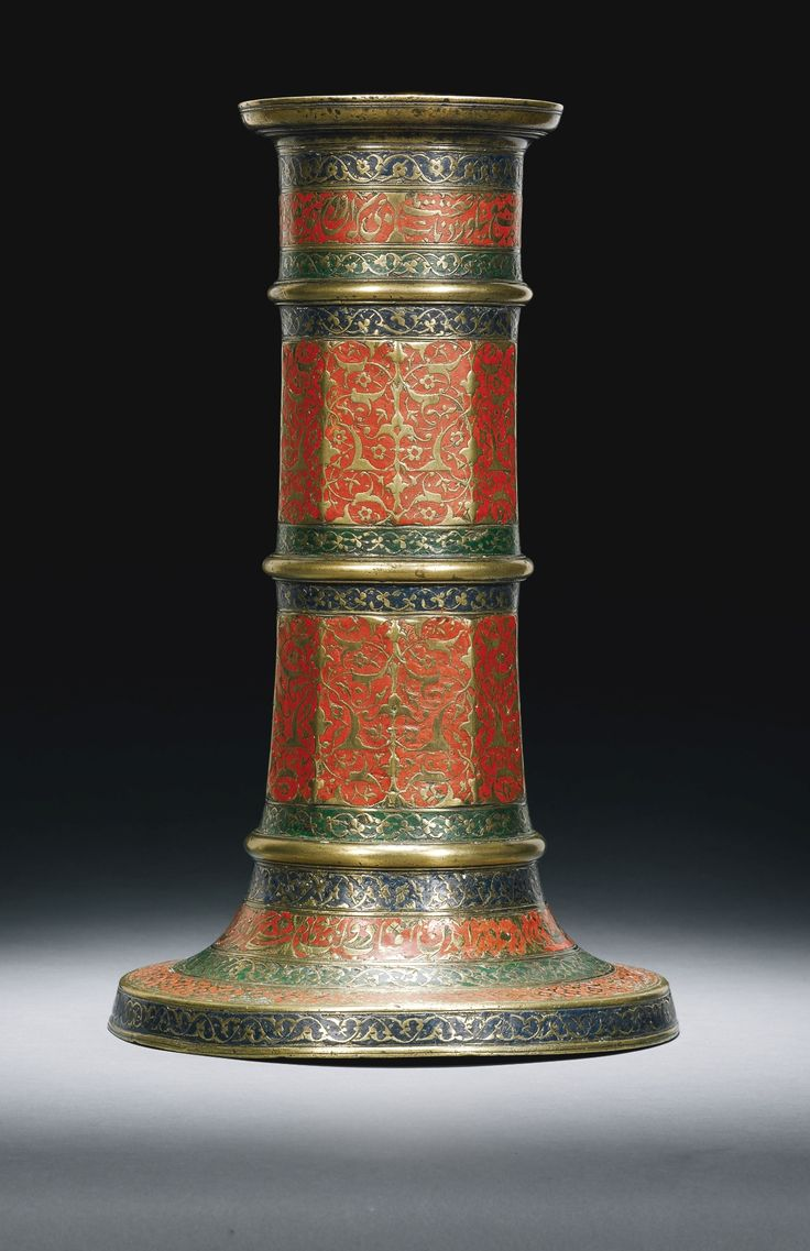 A RARE SAFAVID POLYCHROMED BRASS CANDLESTICK, PERSIA, LATE 16TH CENTURY