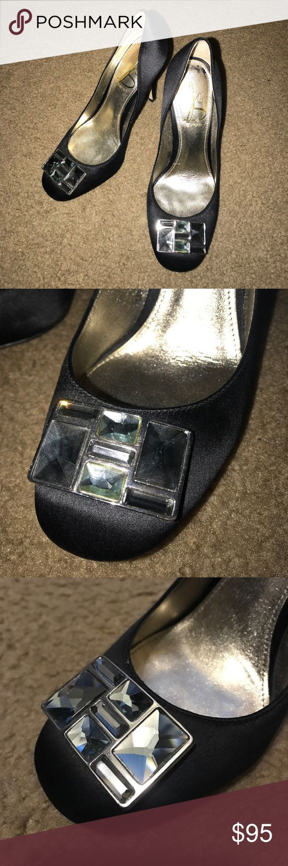 Joan & David black satin heels dress ladies shoes I have a perfect condition black satin dress heels by Joan & David in size 7M. Totally stunning and gorgeous! Joan & David Shoes Heels