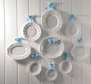Lattice milk glass displayed on wall with ribbon