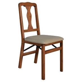 <p>This folding chair has a simple queen anne styling to it - to compliment many traditional dining room sets. The chair is constructed of solid hardwood with steel folding mechanism and padded upholstered seat.  Set of 2 Chairs</p><p> </p><p> </p>