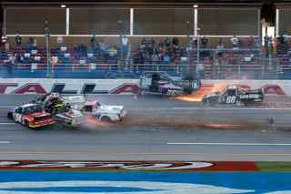 A massive wreck at the end of Saturday's NASCAR Camping World Truck Series race at Talladega Superspeedway saw Miguel Paludo slide on his roof and Kyle Busch ring his bell.