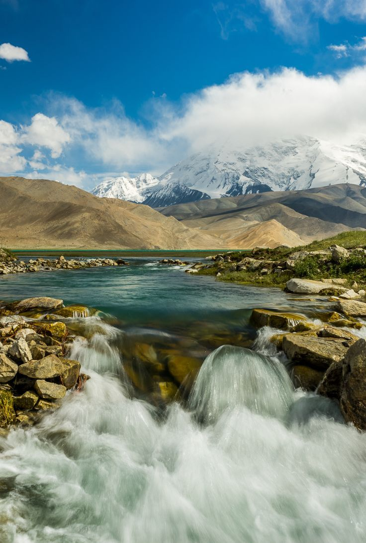 Hiking along the Karakoram Highway in China, we came across this beautiful little stream. We had to stop for a photo. Want to know how to improve your photography skills? Check out of post on Travel Photography for beginners.