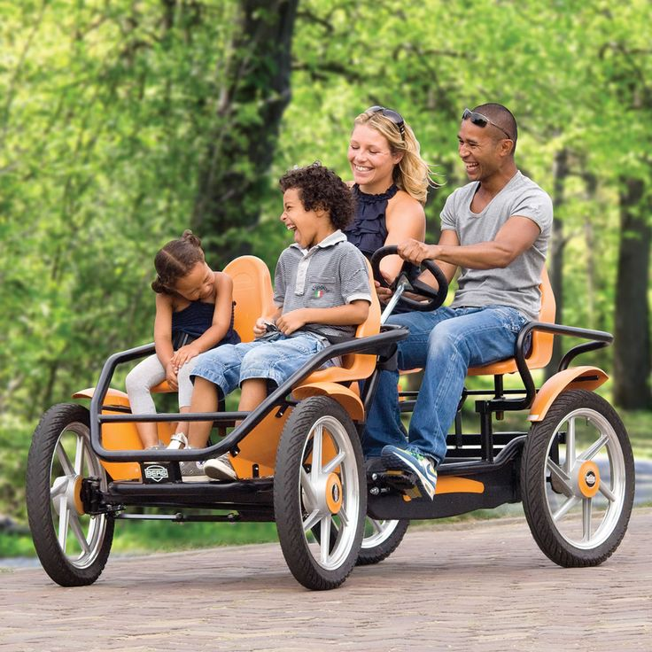 The Touring Quadracycle - This touring pedal-cycle has twin rear seats equipped with pedals that power its rear drive train and allows adults to steer from the backseat.