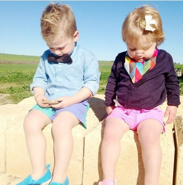 Brother and sister duo rocking their sticks + stones Ziggy bandana and stone bow tie.