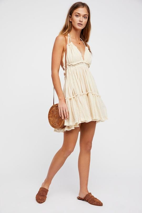 34264d4ed89 This cute summer dress is perfect for lazy beachside days with the girl  gang. Its airy
