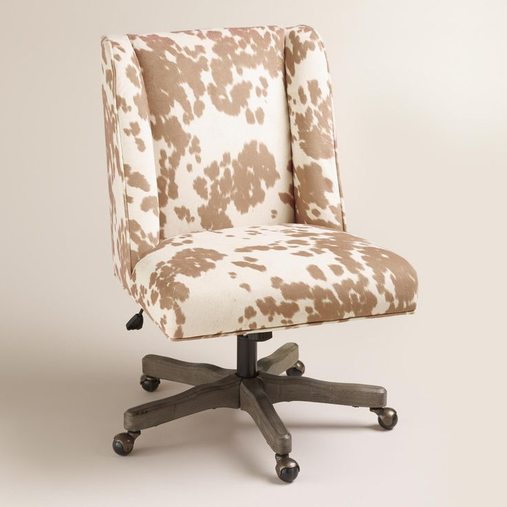 With an updated wingback profile and tan and white cow print fabric upholstery, our comfortable chair is an eclectic home office seating solution.…