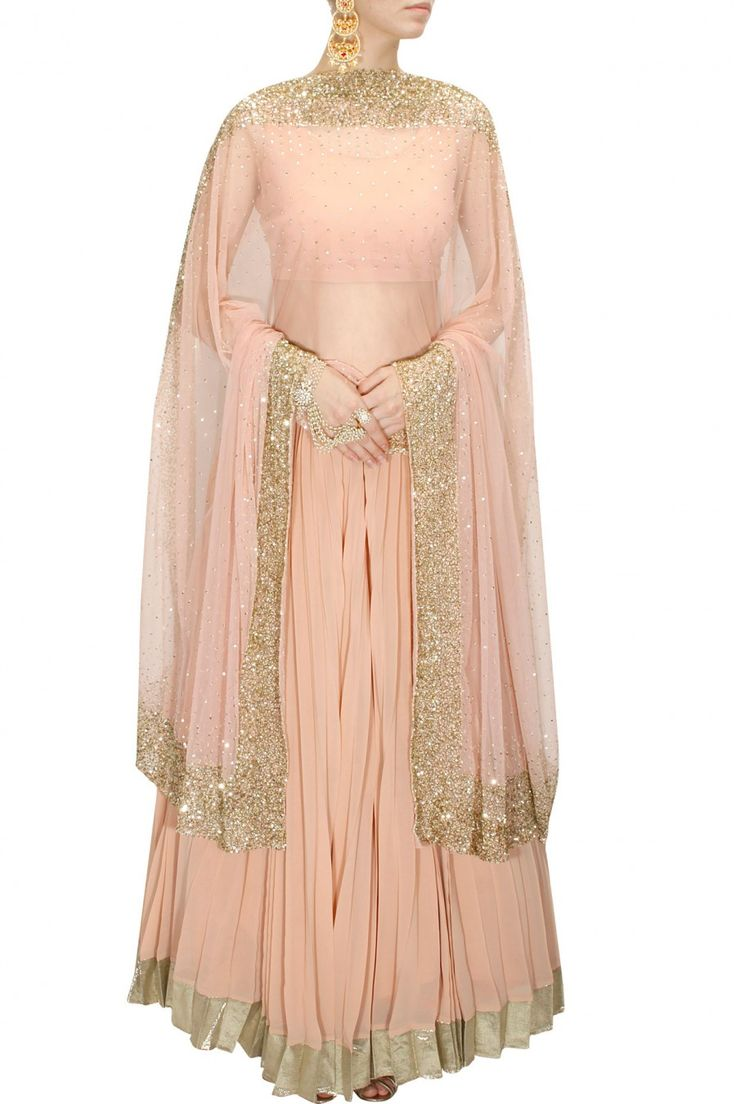 INTRODUCING : Peach and gold sequins embellished lehenga set by Astha Narang. Shop now at www.perniaspopups... #fashion #designer #krishnamehta #shopping #couture #shopnow #perniaspopupshop #happyshopping