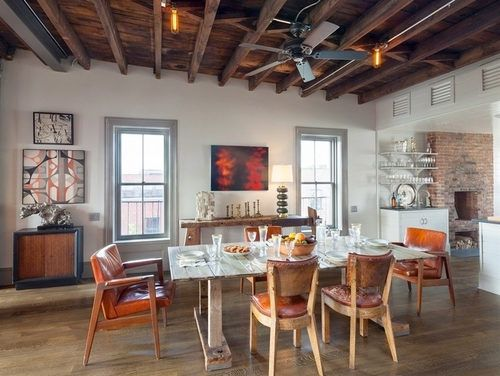 Greenpoint Townhouse has wood flooring, exposed brick, unfinished ceilings, ceiling fan, eclectic artwork and open shelving.