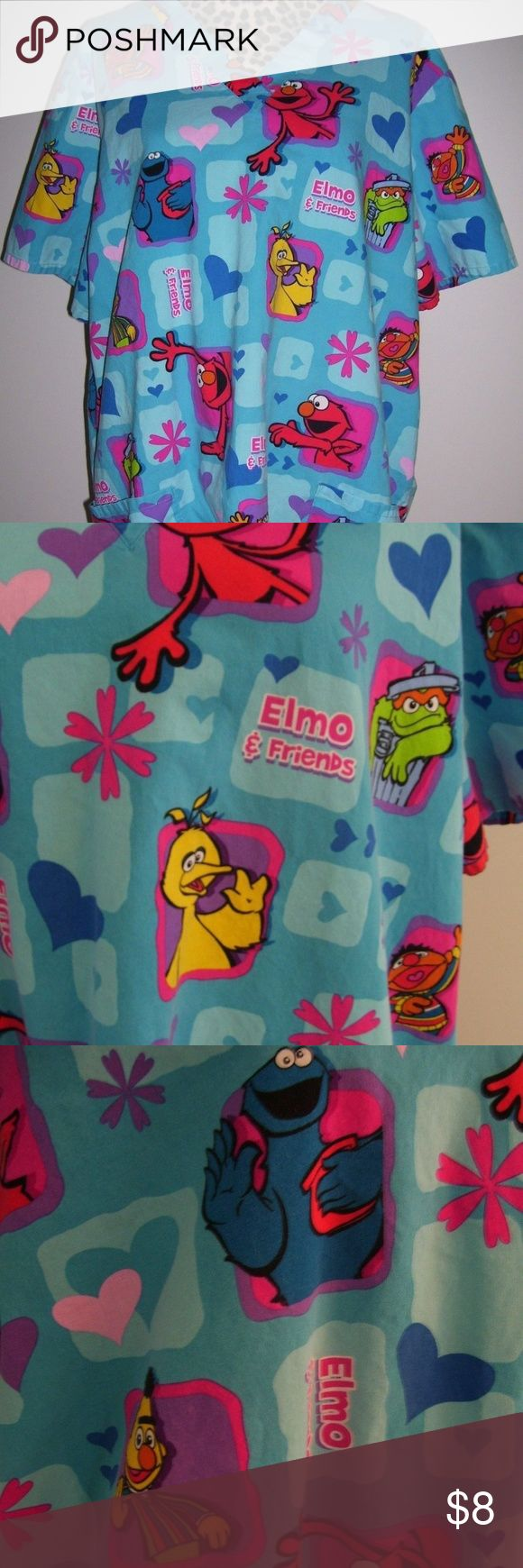 Sesame Street Ladies Size XLarge Scrub Top Sesame Streets Big Bird~ Bert&Ernie~ Cookie Monster~Oscar the Grouch~Elmo Ladies Scrub Top Size XLarge  Preowned: No Rips ~ No Stains ~ No Tears  All of my clothing items are machine washed and dried before shipped!!  Bundle 3+ and receive a 15% Discount!!  Thank you for looking and Happy Poshing!! Sesame Street Tops