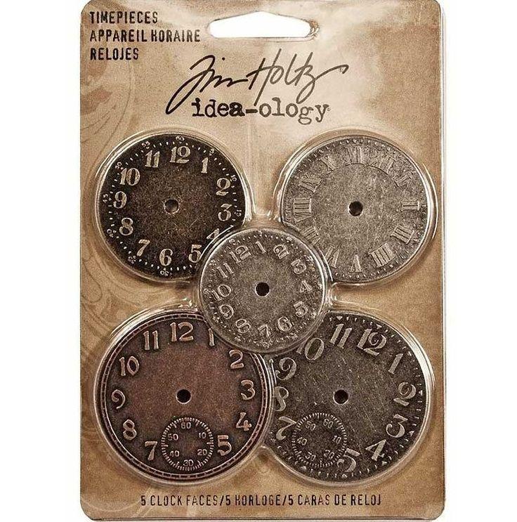 Esferas de Reloj de metal envejecido  Descripción:  5 adornos de la marca Tim Holtz, en metal envejecido, con forma de esferas de Reloj.  Remata y da tu toque personal a tus proyectos, con estas preciosas figuras.