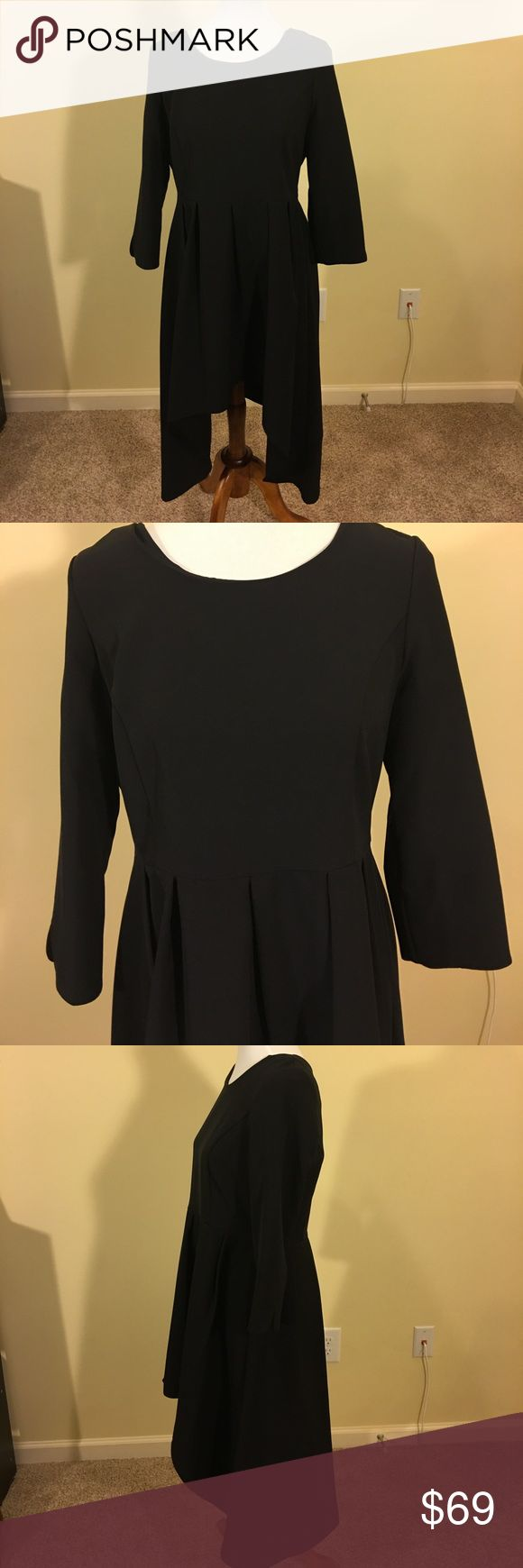 Neiman Marcus Hi/Lo Black Dress Size L Neiman Marcus Hi/Lo Black Dress Size L, lovingly worn, great condition- good for so many occasions. Neiman Marcus Dresses Long Sleeve
