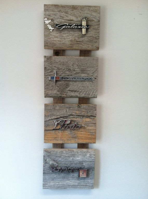 SOLD!! Reclaimed wood adorned with vintage car emblems.  Emblems include: Ford Galaxie, Chevy Corvair, Ford Pinto & Plymouth Voyager.